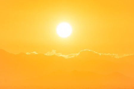sun burst: Sunset over clouds. Big orange sun can be used for natural background