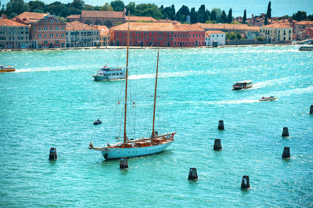 View from Campanile bell tower on yacht in Grand Canal.  Sunny day in Venice, Italy. photo