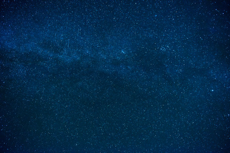 Blue dark night sky with many stars. Milky way on the space background Foto de archivo