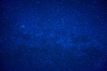 Blue dark night sky with many stars. Milky way on the space background 写真素材