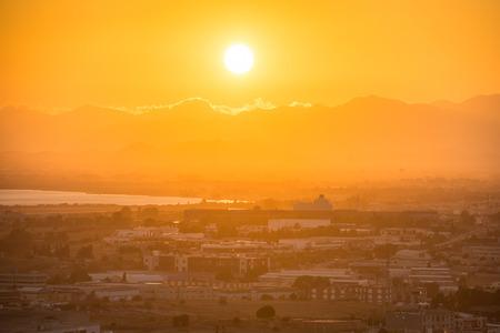 Sunset over european city. Cagliari, Sardinia, Italy. photo
