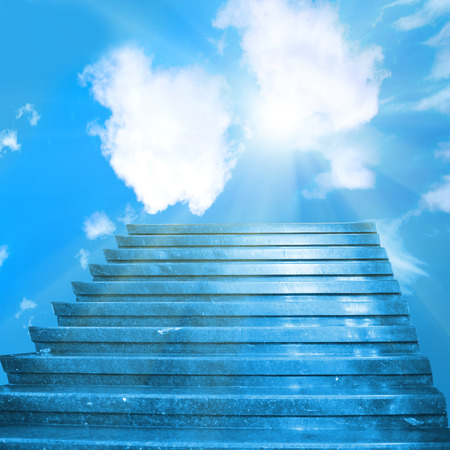 Stairway to heaven. Stairs towards sun on the blue sky with clouds