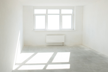 baseboard: White room with window full of light