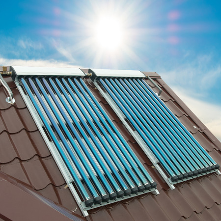 energy supply: Vacuum solar water heating system on the house roof.