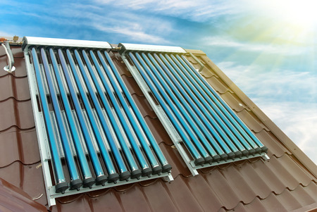 conservation: Vacuum solar water heating system on the house roof.