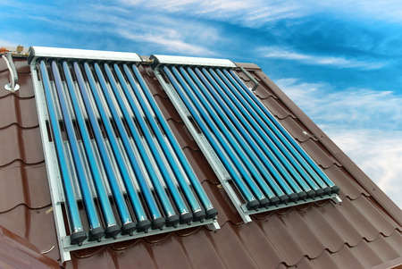 solar collector: Vacuum solar water heating system on the house roof.