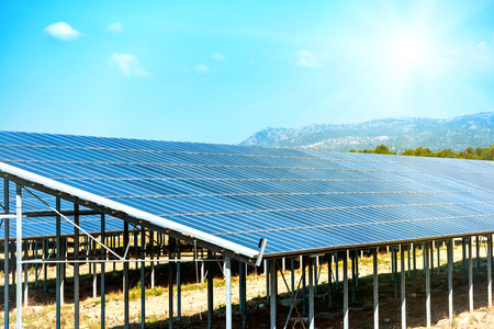 produce energy: Many solar panels that produce green, environmentally friendly energy with bright sun on the blue sky