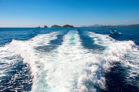 Waves on blue sea behind the speed boat water in sunny day Reklamní fotografie