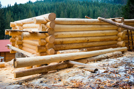new build: Country wooden house. Construction Stock Photo