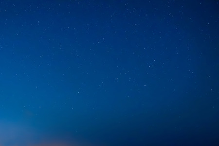Blue dark night sky with many stars. Milky way on the space background 스톡 콘텐츠