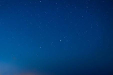 Blue dark night sky with many stars. Milky way on the space background Standard-Bild