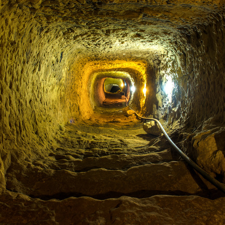 ancient prison: Mysterious dungeon tunnel with walls made of stone