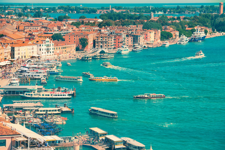View from Campanile bell tower on boats and ships in Grand Canal. Sunny day in Venice Italy. photo