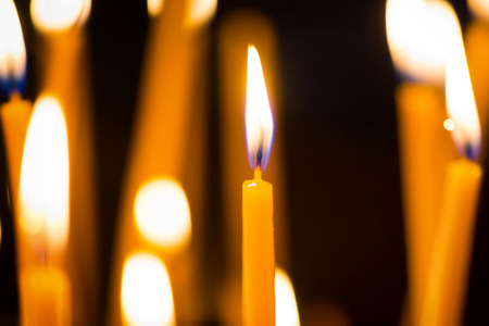 religious: Light of candles on the black background Stock Photo