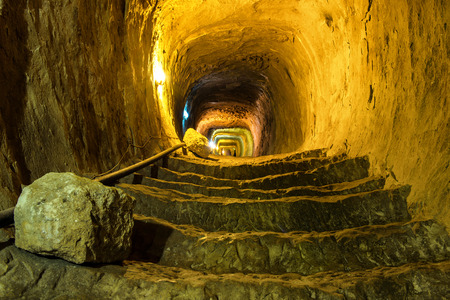 old mining building: Mysterious dungeon- tunnel with walls made of stone