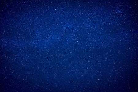 Blue dark night sky with many stars. Milky way like space background 스톡 콘텐츠