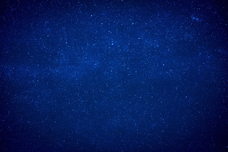 Blue dark night sky with many stars. Milky way like space background Standard-Bild