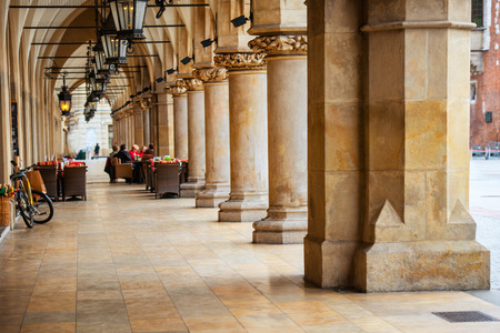 Passage of the gothic hall with columns. Main market square of Krakow city, Poland