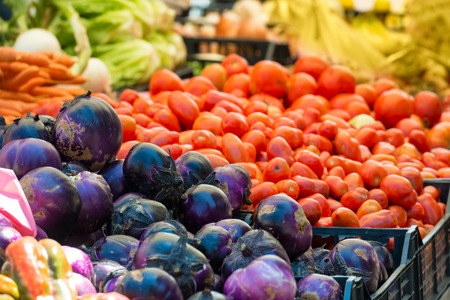 an agricultural district: Fresh vegetables on the market. Red cabbage and tomato.