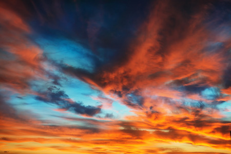 Colorful orange and blue dramatic sky with clouds for abstract background