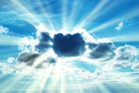 青空: Beautiful blue sky with sunbeams and sun rays through the clouds.