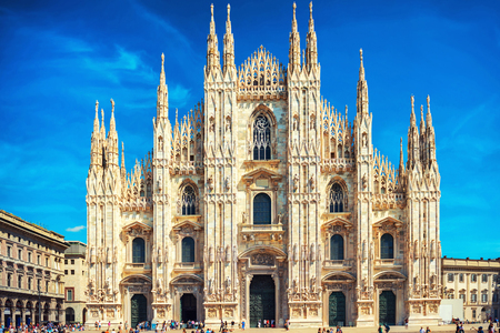 gothic architecture: Daytime view of famous Milan Cathedral Duomo di Milano on piazza in Milan, Italy