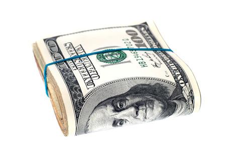 cash: Pila de dinero en efectivo de US dólares aislados sobre fondo blanco Foto de archivo