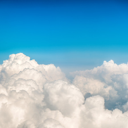 Blue fluffy clouds and sky. Natural background 写真素材