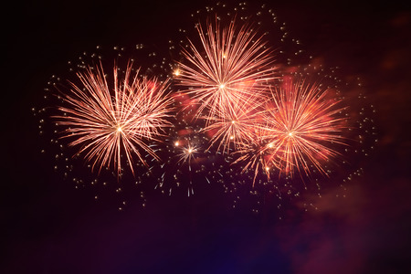 new years day: Red colorful fireworks on the black sky background