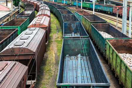 waggon: Many trains with cargo wagons on the railroad