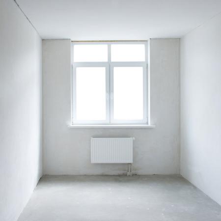 refurbishment: White square room with window. Empty interior space