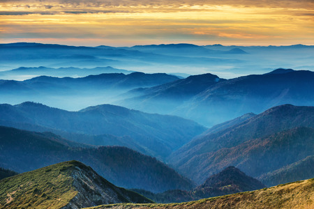 Blue mountains and hills over beautiful sunset Banco de Imagens