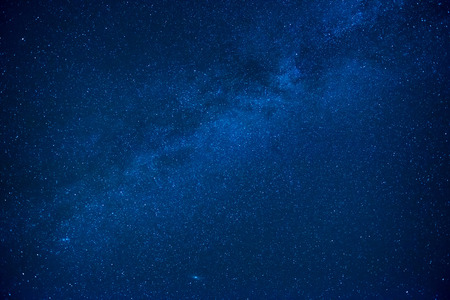 Blue dark night sky with many stars. Milkyway cosmos background Banco de Imagens
