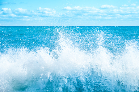 Big wave on the blue sea. Surf and foam 스톡 콘텐츠