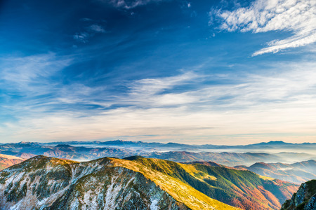 sunset sky: Sunset in the mountains. Landscape with hills, blue sky and clouds