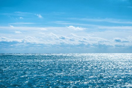Blue sea with sky and clouds. Water natural background