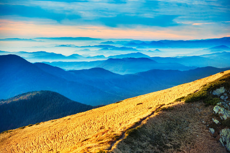 wnc: Blue mountains and hills over beautiful sunset Stock Photo