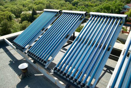 solar collector: Vacuum solar cells for water heating system on the house roof