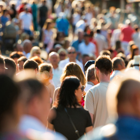 Crowd of people walking on the busy city street. Standard-Bild