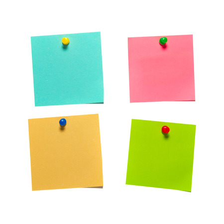 note board: Four different color paper stickers with pins isolated on white background