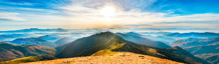 Mountain landscape at sunset. Panorama of beautiful view on hills 스톡 콘텐츠