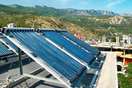 voltaic: Vacuum solar cells for water heating system on the house roof