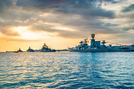 destroyer: Military navy ships in a sea bay at sunset time