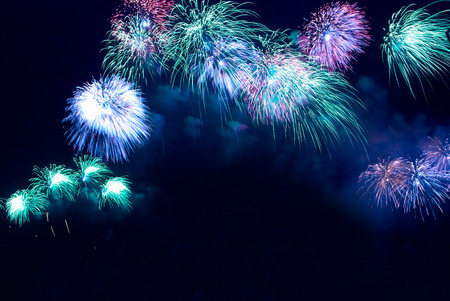 fire works: Colorful blue holiday fireworks on the black sky background