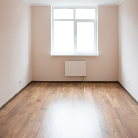 empty room: Light empty room with big white isolated window and wooden floor Stock Photo
