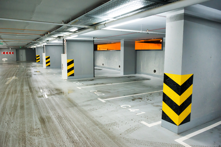 parking lot interior: Empty underground parking with lots for cars