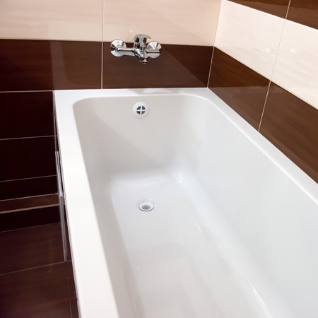 White luxury bathtub in bathroom with ceramic interior 스톡 콘텐츠