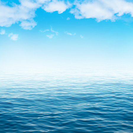 Sea water and blue sky with white clouds. Ocean surface for natural background
