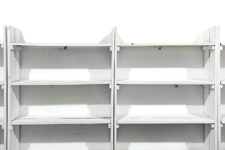 White wooden empty shelves on the store wall