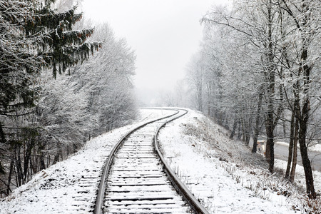 Railway in snow. Winter landscape with empty rail tracks Stock fotó